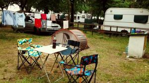The small tent, the dining table, the laundry